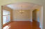 Large formal dining room that is large enough for the whole family!