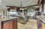 Gas Range plus electric cook-top, 3 dishwashers, 3 sinks, Custom Cherry Wildwood Cabinets artisan granite, wraparound bar