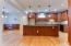Custom Kitchen Cabinets w/ Under-Counter Lighting | Granite top Bar with Wine Cooler