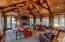 Great Room with Cathedral Ceiling, Wood Beams, Stone Fireplace, and Opens to Screened Porch