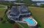 Aerial View of Back of Home with Multiple Verandas, Swimming Pool, and Screened Porch