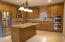Open kitchen with island. All appliances convey.