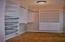 Rare 8' x 6' custom Closet Solutions designed walk-in closet for additional storage in Master Bedroom