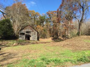 Beautiful wooded lot located on Hubbs Grove rd in Maynardville. This property has a large barn, and a spring running through the center of the property. Multiple building sites are available on the property. City water and electricity are available at the road.