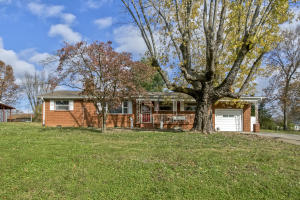 ALL BRICK, well-built one level ranch style home w/large yard & convenient location! Covered front porch & covered back patio, original hardwood floors through most of home.