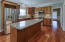 Gourmet kitchen with granite countertops and designer tile backsplash