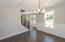 Sleek, modern craftsman moldings and wainscoting in this elegant dining room