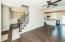 Hand-scraped engineered hardwood floors thru out main