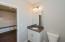 Main level full bath, granite, under mount sink, tub/shower combo, barn wood style tile floors