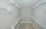 Huge walk-in closet with super-slide closet system