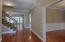 Foyer boasting hardwoods and iron railings on staircase