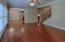 Arched opening gives architectural interest; hardwood floors in great room