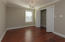 Bedroom 3 with hardwoods, chandelier, and oversized closet