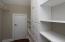 Bonus room has walk-in closet with laminate shelving