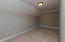 This room is perfect for office, craft/sewing room or workout room!
