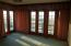 With Solid Wall of Windows and French Doors