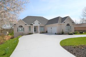 Perched on a circular drive with beautiful new landscaping.