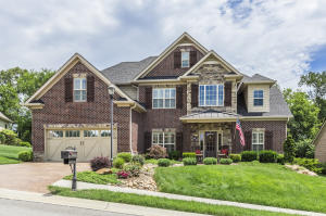 Welcome Home to this Stunning and Meticulous Home! EVERYONE ENJOYS THE ATTRACTIVE FRONT PORCH!!!