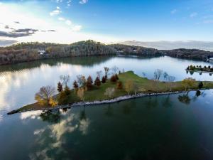 10.77 acre lakefront peninsula.