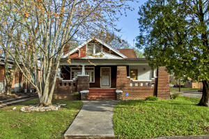 Craftsman Style Brick Home w/Cedar Shake Accents, Huge Covered Front Porch w/Brick Columns, on a Corner Fenced Lot. Great Opportunity w/Both Residential and Commercial Zoning in an Area of Revitalization! Walking Distance to Park, Minutes from Downtown, Market Square, UT, Shopping, Dining, & More!