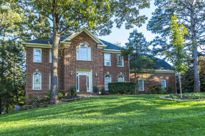 Timeless Brick Traditional Home perfectly sited with Great Curb Appeal. Exterior Windows and Trim are newly painted.