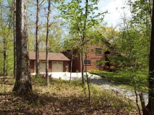 Nestled among mature trees, true year round privacy