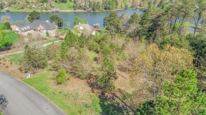 2.82 LAKEFRONT acres in the highly desirable CONKINNON POINTE subdivision.  Build your dream home on these level to gently sloped lots. Owner will divide. Year round deep water. Ground maintenance is taken care of for you by the HOA. What are you waiting for?
