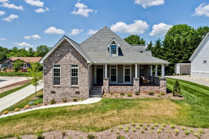 Built in 2018 This Custom Brick and Hardi Shake Home Will Delight You!