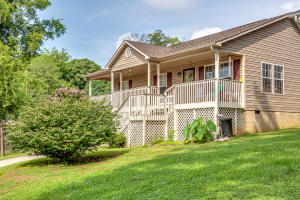 Charming cottage style home in trendy east Knoxville close to the downtown area that is booming .