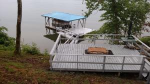 Lower deck and dock. 10 feet deep in summer. 4-5' deep in winter at dock