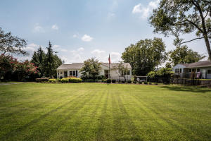 Handsome/ Impressive Front View w/ gorgeous lawn & landscaping