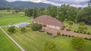 Beautiful home on level fenced 6 acres