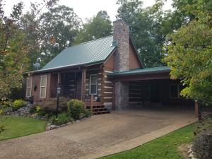 Excellent location with all city utilities. Come see this well maintained 3 bed/2 bath cabin. It has a carport and level ground for motorcycle parking. The sellers have added a 3rd bedroom and recreation room as well as lots of storage space. The walk in closet in the master has been lined with cedar. Upgraded granite countertops in the kitchen. Would make an excellent permanent residence or rental cabin. Everything in this cabin has been done top of the line.