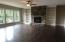 Stone to ceiling gas fireplace. Built-in bookshelves. Lots of natural light.