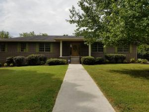 Stately all brick basement ranch in the well established Far View Hills Subdivision. You have a view of downtown. Beautiful in-ground pool with an outdoor kitchen ready for those football parties! Arched doorways in the living and dining rooms. Fireplaces up and down. Double ovens in the kitchen with stainless appliances, granite to be installed. Large 3 BRs on main  plus office down,  hardwood floors throughout. Central Vac System. Heated and Cooled 2 car garage (880 sf). You just can't miss this great deal on such a lovely updated home. Call today for a showing.
