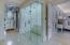 zero entry, shower steam bath with onyx slab back lit walls.