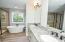 Granite counters. Double Sinks. Tile Floor.
