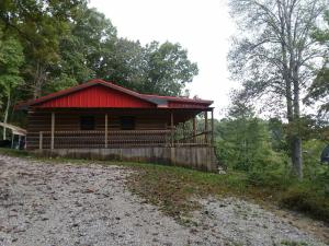 A log cabin in great condition with gorgeous views and acreage for under $200k