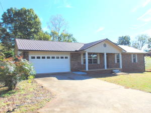 Covered Front Porch, Double Car Garage, Level Lot, Large Deck in Back of Home for Entertaining.