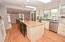 Hardwood floors, stainless kitchen counters, freshly painted cabinets.