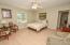 Bedroom 3 is 14 x 15, also with blonde hardwoods