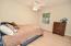 Bedroom 2 is 12 x 11.5 with gorgeous blonde hardwoods