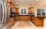 Updated kitchen with beautiful cabinets and appliances.