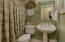 FULL BATH AS POWDER ROOM AND SERVING BEDROOM 2