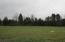 Remainder of property lays behind tree line