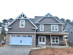 Craftsman style exterior w/ double door entry and covered front porch.