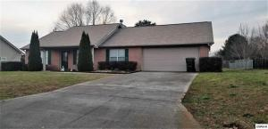 Nice 3 bedrm 2 ba rancher in Sevierville city. Unbeatable location with city utilities & a large fenced back yard. Home features a 230 sq ft sun room addition, open concept split bedrm floor plan, wood & tile flooring, cathedral ceiling, corner bricked fireplace & more. The kitchen boasts of ample white cabinetry, pantry, & new stainless refrigerator included in sale. Enjoy having the laundry/ mud room off garage next to kitchen. Garage has storage overhead in addition to a storage room. There's alot to appreciate about this home. Sellers in process of moving, 2 bedrms empty therefore not included in photos. Hot tub off sun room is included in sale. Sq Ft is approximate & includes sun room addition. Buyer to confirm all pertinent information. Don't let this one get away,