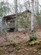 Looking for a custom designed Smoky Mtn getaway cabin in Wears Valley area  without an HOA? This is it!  This one bedroom cabin is perfect for weekend or overnight stays!  Currently rented as long term rental.  8 Wooded acres offers privacy and easy access without steep mountain roads. 15 minutes from downtown Pigeon Forge and Dollywood!