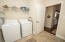 Tiled laundry room/mud room and extra storage closet