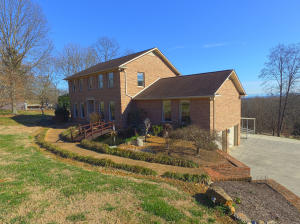 Setting in West Knoxville with Country Setting and 5.75 acres.